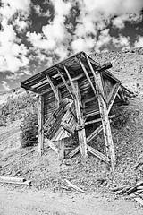 Ore Loading Chute (wyojones) Tags: montana ruins workings homestakemine hendersonmountain newworldminingdistrict cookecity mine valley feocene absarokavolcanicssupergroup ore volcanicrocks miningcity gold clouds sky cloudscape absarokamountains