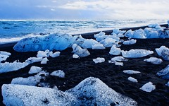 Diamonds (Caleb Bertolini) Tags: iceland olympus sky blue white water bay ocean ice glacier rocks rock landscape nature natural scenery frozen golden circle cloud clouds change cold beach winter snow horizon black sand outside diamond diamonds