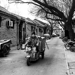To keep it clean (Go-tea 郭天) Tags: pékin républiquepopulairedechine beijing hutong narrow alley old ancient construction building bricks pavement history historical historic traditional tradition sun sunny shadow cold winter motorbike motorcycle tricycle man alone lonely ride riding rider movement uniform hat cap cleaner duty busy portrait trees bicycle bike tools equipment equiped street urban city outside outdoor people candid bw bnw black white blackwhite blackandwhite monochrome naturallight natural light asia asian china chinese canon eos 100d 24mm prime worker clean