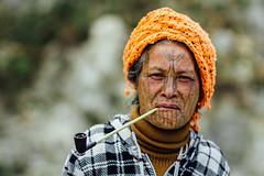 M'uun Tribal Woman With Tattooed Face and Pipe, Chin State Myanmar (AdamCohn) Tags: adam cohn burma chinstate muun muuntribe mindat myanmar ethnicminority face facetattoo facialtattoo pipe portrait rural smoke smoking streetphotographer streetphotography tattoo villager wwwadamcohncom မင်းတပ် adamcohn