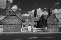 The Countess of Derby's Almshouses (IanAWood) Tags: converted720nmirsensor digitalinfrared fullspectrumphotography harefield infraredblackandwhite lbofhillingdon nikkorafs1224mmf4gdx nikond70ir walkingwithmynikon westlondon thecountessofderbysalmshouses churchhill countyofmiddlesex listedbuildings oldbuildings socialhousing charitablehousing londonarchitecture londonbuildings brickbuildings exteriorofhouses