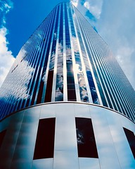New clothes (joanne clifford) Tags: clouds city tower skyscraper glass modernism reflections windows blue design change retrofit architecture shopify ottawa 234laurier hww windowwednesday