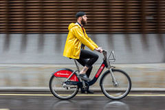 London rainwear (jeremyhughes) Tags: bikeshare santander 80200mmf28 nikkor d810 nikon hipster bearded beard yellow bike bicycle city motion movement panning streeturban rainwear rainraining cyclist cycling london raincoat slicker beret tattoo street
