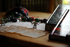 Minature guarding the hoard (valkyrieflamephotography) Tags: macro close table tabletop minature card dice die book rpg light