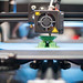 Close-up of a 3D printer printing a small toy figure
