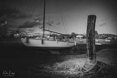 Tied (PKpics1) Tags: boat tied moored chain harbour porlock weir landscape post rope blackandwhite blackwhite