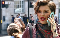 """""""He's out with his secretary...."""" (markwilkins64) Tags: streetphotography street candid boroughhighstreet london mobilephone attractive woman lady humour markwilkins lipstick makeup scarf crossing headphones leatherjacket drama emotion concern dramatic pedestriancrossing nosering uk"""