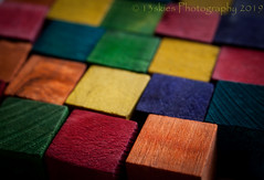 Coloured Squares (HMM) (13skies) Tags: wood colors colours macro dof coloured blocks macroscopic sonyalpha100 sony yellow red orange blue close depthoffield