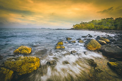 Sunset seascape with rocky beach and crashing waves, Rocks and stone in the sea with wave on sunset time, Nature landscape of Chumphon, Thailand. (Shutter9Aum) Tags: bay sunsetbeachsand beauty reflection dawn wallpaper colorful sundown surface clearwater tide nobody bluesky shoreline twilight tropical calm seaside splash sunrise sun sand dusk tranquil shore orange sunlight evening coast background scenic horizon cloud summer travel blue rock ocean beautiful sky sunset seascape rocky beach crashing stone sea wave nature landscape