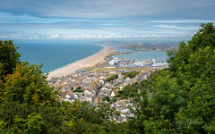 Chesil View (Explore 16/08/2019) (RTA Photography) Tags: fortuneswell chesilbeach dorset jurassic coast isleofportland trees view outdoors landscape rtaphotography nikon village d750 tamron2470mmf28vcusd framed sky clouds blue weymouth explore