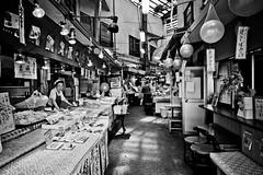 (Camera Freak) Tags: 190812ryogokud810tokyoryogoku2019augustnikond810 kameari market shop tokyo japan vegetables fish counter stool lamps japanese shopping nikon d810 24120mm monochrome bnw blackandwhite