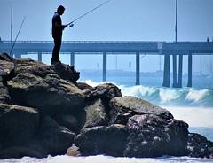 Fishing on the rocks (thomasgorman1) Tags: fishing reel rod outdoors shore rocks fisherman man pier coast sea la canon california venice wave ocean travel
