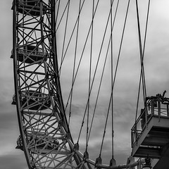 Looking Up at the London Eye (2 of 3) (Patricia Wilden (Away until February)) Tags: lookingup london ©patriciawilden2019 lumixdmcg1k structure blackandwhite moon monochrome londoneye southbank 17nov2018 ride metal landmark sightseeinglondon 14mar2018 pov