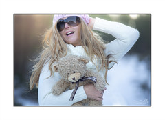 Happy exuberant woman outdoors with backlight from sun (sugarbellaleah) Tags: winter woman snow joy happiness female hair wavy blonde sunglasses knitted sweater fashion teddybear fun lifestyle outdoors shallowdof holding season holiday vacation woodland forest bush bushland rural countryside backlit sun cuddly