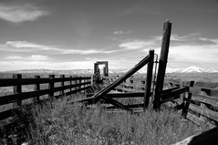 Way Out There (nedlugr) Tags: california ca usa sanluisobispocounty carrizoplain carrizoplainnationalmonument corral gate fences blackandwhite bw clouds