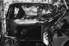 What you lookin' at? (Analog World Thru My Lenses) Tags: nikonfa nikkor100mmf28seriese ilforddelta100 july 2017 abandoned forgotten urbex classiccars vintage rust tusty rusty rustinpeace zastava analog film 35mm bw blackandwhite