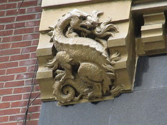 Radiator Building Art Deco Gold Dragon No Wings Gargoyle 7877 (Brechtbug) Tags: 2019 radiator building art deco dragon without wings gargoyles across bryant park new york public library from midtown manhattan 08142019 nyc shadow cityscape architecture city buildings shadows american standard skyline labor seven 7 deadly sins dragons shark dolphins women men classical garment district gnome ceramic tile golem monster gollum lord rings like creature magic dwarf