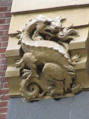 Radiator Building Art Deco Gold Dragon No Wings Gargoyle 7882 (Brechtbug) Tags: 2019 radiator building art deco dragon without wings gargoyles across bryant park new york public library from midtown manhattan 08142019 nyc shadow cityscape architecture city buildings shadows american standard skyline labor seven 7 deadly sins dragons shark dolphins women men classical garment district gnome ceramic tile golem monster gollum lord rings like creature magic dwarf