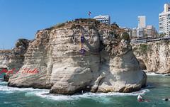Cliff diving Raouche Lebanon (Paul Saad) Tags: lebanon beirut cliff diving sea beach raouche water waves rock city building nikon