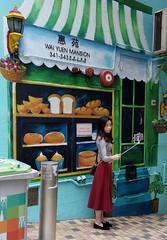 Bakery Selfie (cowyeow) Tags: saiyingpun china street chinese asia asian 香港 hongkong city urban composition graffiti wall streetart painting girl woman candid cute pretty young asiangirl chinesegirl bakery color colors