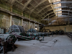 Turbine Hall (Hooismans) Tags: abandoned abandon abandonné abandonnée abbandonato abbandonata ancien ancienne alone architecture explorationurbaine exploration explore exploring empty explo explored distillery trespassing rust rusty ruins rotten urbex urban urbain urbaine urbanexploration interdit interior inside inexplore old past photography decay decaying derelict dust decayed dusty forgotten forbidden lost light nobody neglected building verlassen creepy huge industrial factory ceiling people arch road sign tree sky powerplant centrale controlroom turbine