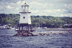 White light.... (Joe Hengel) Tags: whitelight burlington burlingtonvt vermont lighthouse lake lakechamplain boats boat boatdock town forest trees lakescape waves water afternoon cloudy clouds sky jetty burlingtonbreakwaternorthlighthouse