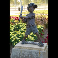 Statue of a little boy playing backyard baseball, with flowers behind. Taken on 7-19-19, at Lakewood Park in Lakewood, Colorado.  ~ ~ ~ ~ ~  #CanonRebelT5 #Canon #Rebel #T5 F/6.3 48mm 1/125s ISO-320 #statue #littleboy #backyardbaseball #flowers #LakewoodP (oooshinyphotography) Tags: lakewoodpark hashtagcolorado flowerphotography canonrebelt5 backyardbaseball boy coloradoshared coloradotography canon oooshiny colorado colorcaptures statuephotography t5 coloradolove flowers rebel statue coloradocreative lakewood flower coloradophotography oooshinyphotography viewcolorado coloradophotographer littleboy baseball coloradocollective