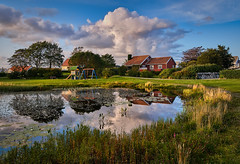"""Isdammen"", Haugesund - Norway (Vest der ute) Tags: xt20 norway rogaland haugesund water landscape reflections grass foliage houses sky clouds trees summer evening fav25 fav200"