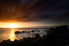 Cloudy sunset (Rico the noob) Tags: dof rock d850 landscape sunset 20mm water outdoor stones sea longexposure published beach ocean sun travel sky coast rocks tenerife 2018 teneriffa 20mmf18 clouds nature