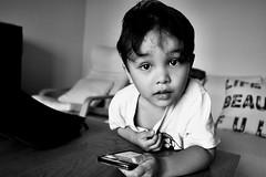 Surprice surprice... (einarsoyland) Tags: fujifilm xt30 xf18mmf2r blackandwhite bw monochrome boy portrait fuji fujinon