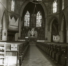 H002661 Interior of St. Saviours Church, Eastbourne (East Sussex Libraries Historical Photos) Tags: church eastbourne aisle pews stsaviourschurch architecture altar windows