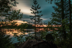 July sunset III (mabuli90) Tags: finland lake sunset longexposure nature forest tree sky water night dusk landscape