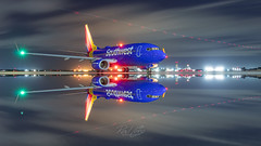 Self reflecting (RaulCano82) Tags: swa southwestair swapic southwestairlines raulcano n7880d boeing boeing737 jet plane airliner aviation airplane avgeek airport canon 80d photography night reflection water sky longexposure southwest houston htx htown hou houstontx houstontexas khou