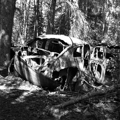 carcemetery022 (salparadise666) Tags: car cemetery near ryd rolleiflex sl 66 planar 80mm fomapan 100 boxspeed caffenol cl nils volkmer sweden landscape nature detail forest wood bw black white monochrome analogue medium format 6x6 square