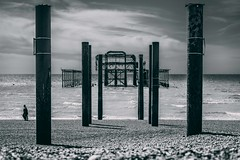 Silver ruins (alejandromarquezph) Tags: bnw brighton store street streetphoto water bar black blue brick chairs chips city clouds colour cream dock eat eating fish flags food gelatto harbor ice light log orange path pebble people pier restaurant ruins rusty sea shore signs sky stable travel uk unitedkingdom waves white wood