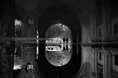 2x2 (maekke) Tags: zürich reflection puddlegram pointofview pov rain silhouette fujifilm x100f 35mm switzerland ch streetphotography 2019 bw noiretblanc architecture