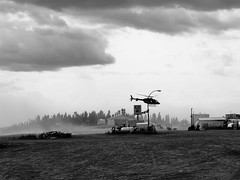eagle plains gas startion with heli (2) (oneofmanybills) Tags: eagleplains dempsterhighway yukon canada helicopter gas station olympus micro43 bw blackandwhite dusty clouds