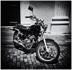 Lomography (Black and White Fine Art) Tags: holga holga120s toycamera camaradejuguete plasticcamera camaradeplastico kodaktmax400exp2008 kodakd76 motora motorcycle sanjuan viejosanjuan oldsanjuan puertorico bn bw niksiverefexpro2 lightroom3