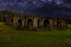 Sunning stars and milky way over the ruins of the historic gold mine (stewart.watsonnz) Tags: sky building architecture grass ruins outdoors night arch castle abandoned noperson bunker nature travel landscape ground old history countryside light boardwalk ancient crypt dark astronomy outerspace tree scenery dome stonewall wall field rubble starrysky wilderness milky way stars galaxy galactic grassland bench fort monument land