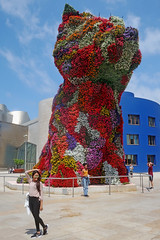 Posers, Photographers, and Puppy - Guggenheim Museum, Bilbao, Spain (TravelsWithDan) Tags: women posing photographer plaza outdoors city urban puppy flowers sculpture publicart jeffkoons guggenheimmuseum bilbao spain europe candid sunshine summer canong3x