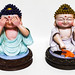 Buddha figurines isolated on white surface