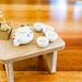 Close up of miniature porcelain set and food basket