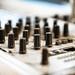 Macro shot of audio mixer knobs