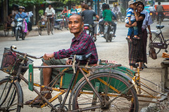 The Trishaw Driver (shapeshift) Tags: street travel people man bicycle waiting asia southeastasia downtown traffic burma streetphotography documentary motorcycles pedestrians myanmar journalism sidecar socialdocumentary trishaw shapeshift rakhine sittwe davidpham rakhinestate myanmarburma davidphamsf shapeshiftphoto portrait candid happyplanet asiafavorites