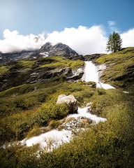 The stream created by the melting of the glacier (Oash_Dany) Tags: italy cielo montagna paesaggio nuvola crepuscolo calma shadows sonyalpha sunnyday clouds cloudy beautiful colors sony outside cloud color paysage nuvole orange day dynamic long exposure roccia sunrise mountain alps alpi