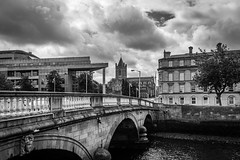 Wood Quay - Dublin, Ireland (Gullivers adventures) Tags: brianboru christchurch liffy ireland dublin bnw monochrome architecture archeology eire dublincity bride clouds atmosphere buildings river tree windows cathedral