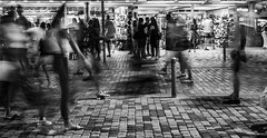 Casually (Adeypoos) Tags: longexposure streetlevelphoto streetphotography streettogs motionblur blackandwhite blur shopping tourist sonya7iii sony50mmf18 paphos pafos greece cyprus