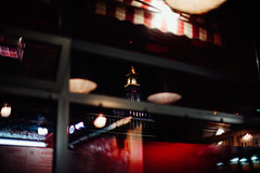 Hide and seek (ewitsoe) Tags: 50mm city lights nikond750 spring street erikwitsoe night people poland shadows urban warsaw palaceofcultureandscience window insidelookingout evening peakingout building interior reflection warmnight