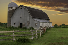 Soft Light Of Perspective (henryhintermeister) Tags: barns minnesota oldbarns clouds farming countryliving country sunsets storms sunrises pastures nostalgia skies outdoors seasons fields hay silos dairybarns building architecture outdoor winter serene grass landscape plants cloudsstormssuns rushcitymn