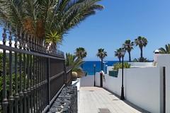 Playa Honda Fence (•Nicolas•) Tags: canaryislands holidays lanzarote m9 nicolasthomas spain fence playa street sky beach town